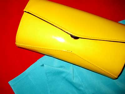 Red pencil skirt, top that is more teal than this photo suggests, and yellow clutch